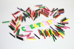 Creativity character ,School supplies colored pencils in Fall scattered, isolated Stock Photos