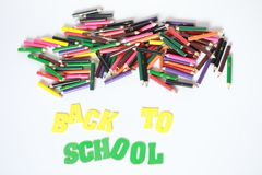 Back to school ,School supplies colored pencils in Fall scattered, isolated. School supplies colored pencils in Fall scattered, isolated on a white background Royalty Free Stock Photo