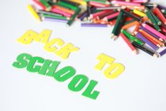 Back to school ,School supplies colored pencils in Fall scattered, isolated. School supplies colored pencils in Fall scattered, isolated on a white background Stock Images