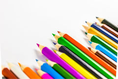 School supplies colored pencils in a row. Isolated on a white background Stock Image