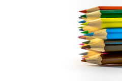 School supplies colored pencils in a row. Isolated on a white background Royalty Free Stock Images