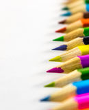 School supplies colored pencils in a row. Isolated on a white background Stock Photography