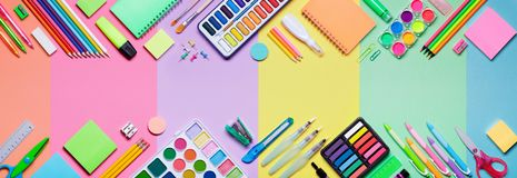 School Supplies With Colorful Paper Background Royalty Free Stock Photos