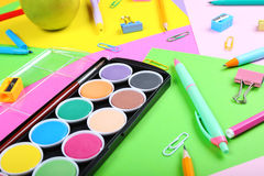 School supplies on colorful papers background, close up Royalty Free Stock Photo