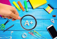 School supplies in the creative school desk, stationery, school concept, blue background, creative chaos, space for text, markers, stock photos
