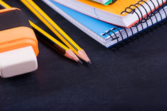 School Supplies on a dark background Royalty Free Stock Images