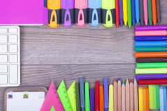 School supplies. On a dark background and place for text, selective focus and small depth of field Stock Images