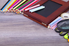 School supplies. On a dark background and place for text, selective focus and small depth of field Stock Photography
