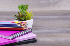 School supplies. On a dark background and place for text, selective focus and small depth of field Royalty Free Stock Photography