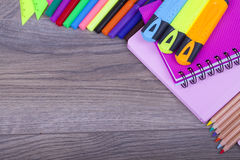 School supplies. On a dark background and place for text, selective focus and small depth of field Royalty Free Stock Image