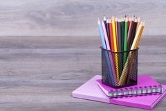 School supplies. On a dark background and place for text, selective focus and small depth of field Stock Photo