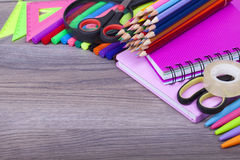 School supplies. On a dark background and place for text, selective focus and small depth of field Royalty Free Stock Images