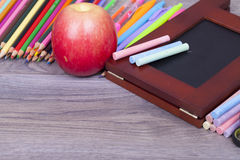School supplies. On a dark background and place for text, selective focus and small depth of field Royalty Free Stock Photos