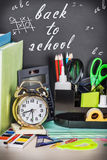 School supplies on the desk in the background of chalkboard Royalty Free Stock Photography