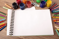 School supplies on desk with blank art book, copy space Stock Photography