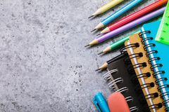 School supplies on the desk with copy space. Top view on pencils and notebooks stock photo