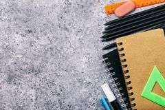 School supplies on the desk with copy space. Top view on pencils, notebooks and more royalty free stock photo