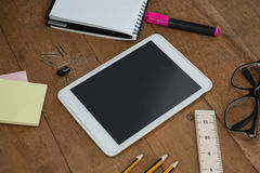 School supplies, digital tablet and spectacles on wooden table Stock Photo