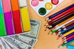 School supplies and dollars. Concept is to buy stationery objects. Top view Stock Images