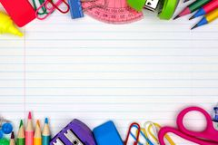 School supplies double border on lined paper background. Colorful school supplies double border over a lined paper background