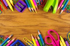 School supplies double border on wood desk Stock Images