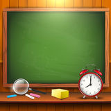 School supplies and empty blackboard Royalty Free Stock Images