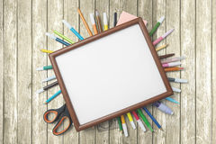 School supplies with empty frame on the table Royalty Free Stock Photo