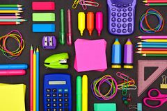 School supplies flat lay on a chalkboard stock photography
