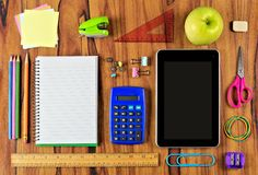 School supplies flat lay on wood desk Stock Images