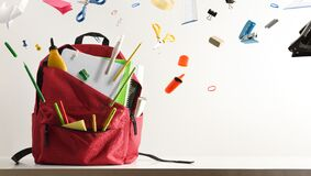 Free School Supplies Flying And Coming Out Of School Backpack Stock Photo - 222499590