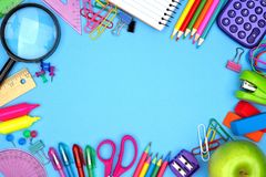 School supplies frame against blue Stock Image