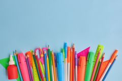 School supplies frame. On a blue background stock photo