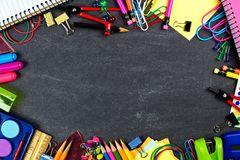 School supplies frame on chalkboard Stock Image