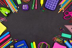 School supplies frame on chalkboard background royalty free stock images