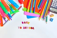 School supplies frame. On a light background royalty free stock image