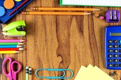 School supplies frame on wood desk background Stock Photography