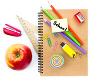 School supplies with Globe, apple, pencils and notebook  on whit Stock Image