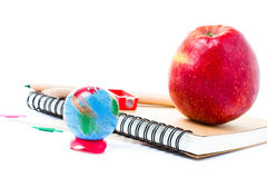 School supplies with Globe and notebook  on white background Stock Photos