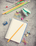 School supplies on gray stone background Royalty Free Stock Images