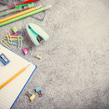 School supplies on gray stone background Royalty Free Stock Photo