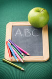 School supplies and green apple Stock Photography