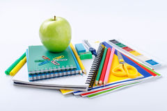 School supplies with green apple Stock Photo
