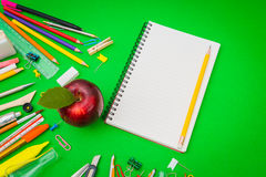 School supplies on Green chalkboard  Back to school background Stock Images