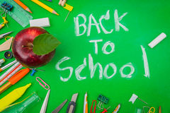 School supplies on Green chalkboard  Back to school background Stock Photos