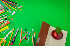 School supplies on Green chalkboard  Back to school background Stock Photography