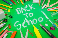 School supplies on Green chalkboard  Back to school background Royalty Free Stock Photos