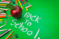 School supplies on Green chalkboard  Back to school background Royalty Free Stock Photography