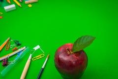 School supplies on Green chalkboard  Back to school background Stock Photo