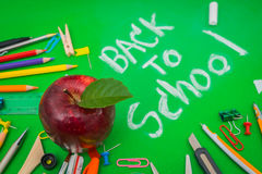 School supplies on Green chalkboard  Back to school background Royalty Free Stock Photo