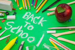 School supplies on Green chalkboard  Back to school background Royalty Free Stock Images
